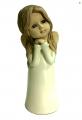 фото статуэтки ангела в белом платье